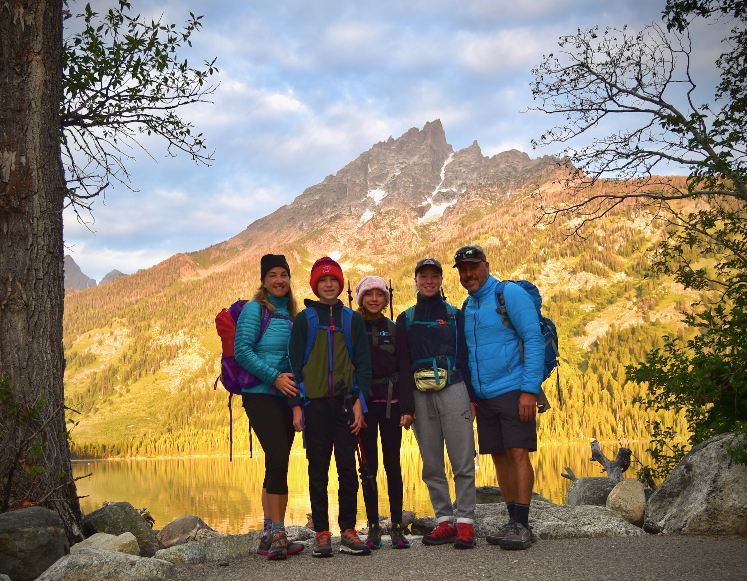 family at sunrise at Jenny Lake.